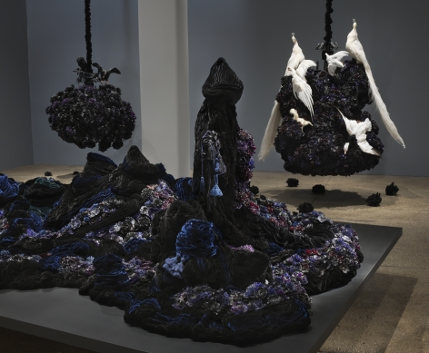 Petah Coyne Untitled #1379 (The Doctor's Wife), 1997-2018 Specially-formulated wax, pigment, silk flowers, silk/rayon velvet, tassels, Cast-wax statuary figures, human hair, black pearl-headed hat pins, wire, thread, felt, cotton batting, chicken-wire fencing, wood, masonite, steel, acrylic paint, nails, bolts, screws, washers, wing nuts, latches, 3/8″ Grade 30 proof coil chain, cable, cable nuts, shackles, Velcro, plastic 96 x 193.5 x 97.5 inches (243.8 x 491.5 x 247.7 cm)