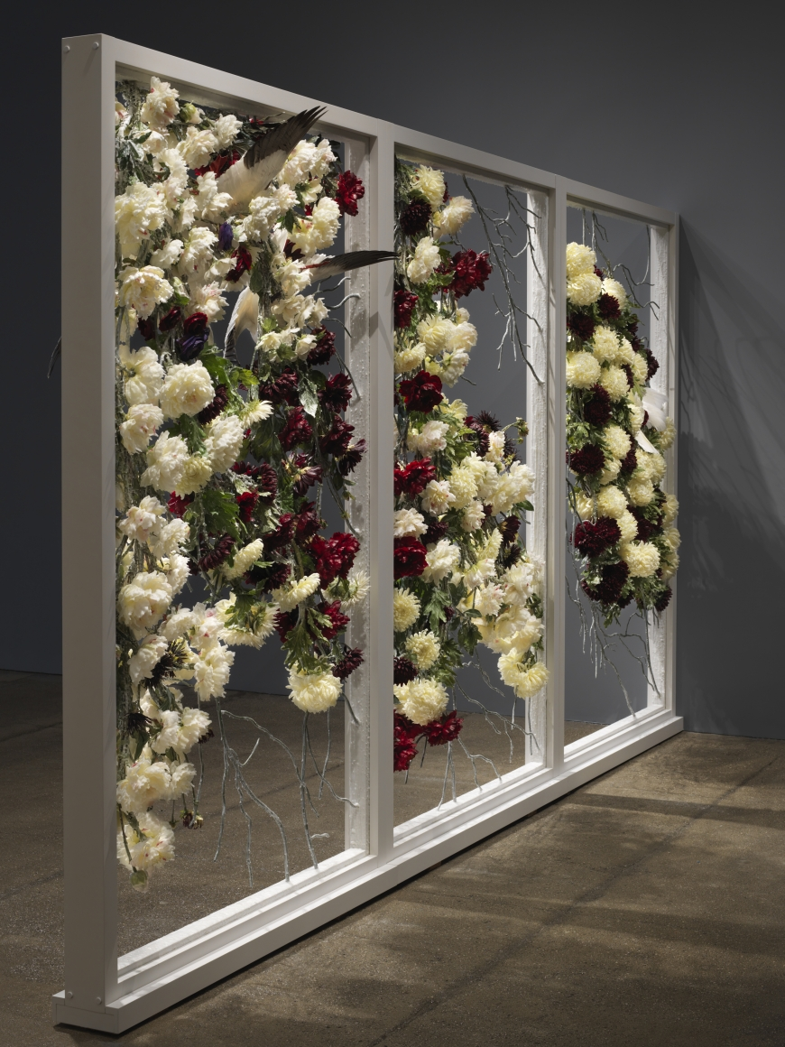 Petah Coyne Untitled #1388 (The Unconsoled), 2013-14 Specially-formulated wax, pigment, silk flowers, taxidermy, paint, thread, wire, floral tape, steel, metal hardware, maple, birch plywood, aluminum 96 x 60 x 12 inches (182.8 x 152.4 x 30.5 cm)