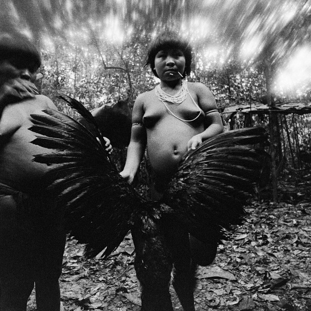 Candinha and Mariazinha Korihana thëri clean curassow, whose feathers are used to fledge arrows, Catrimani, Roraima State, Brazil, 1974. Photo © Claudia Andujar.